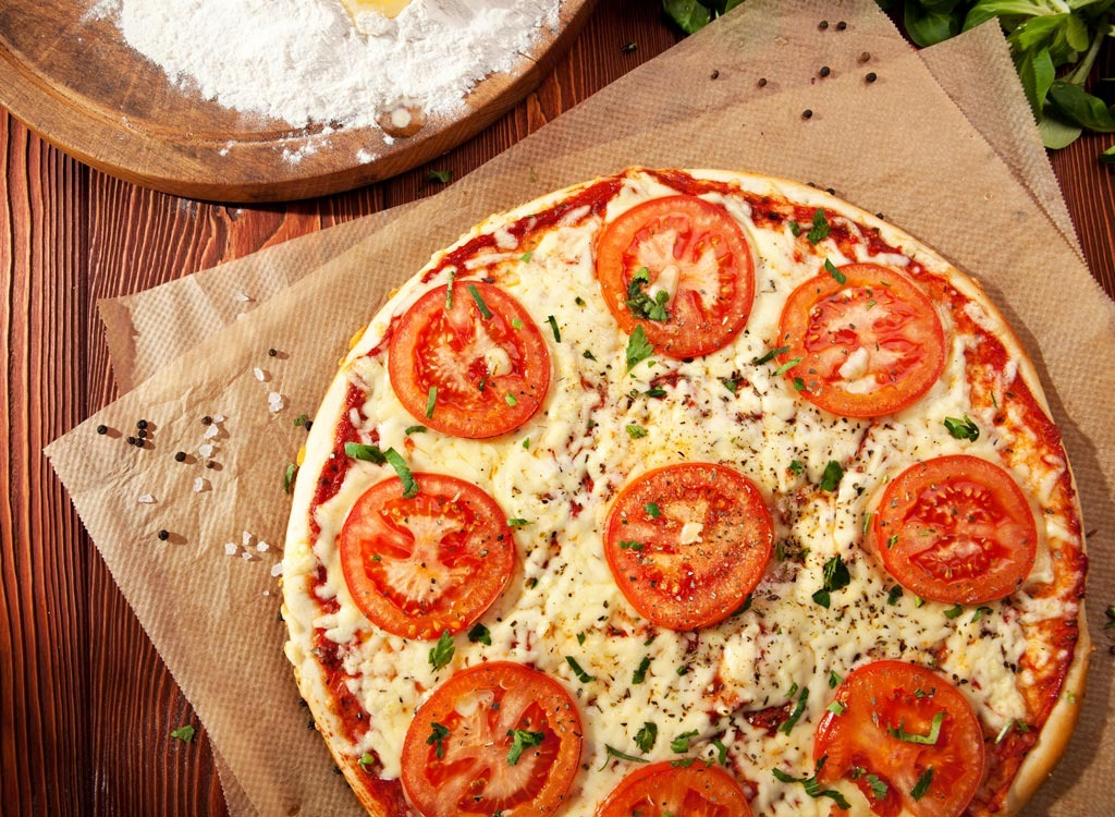 Pizza with tomato slices