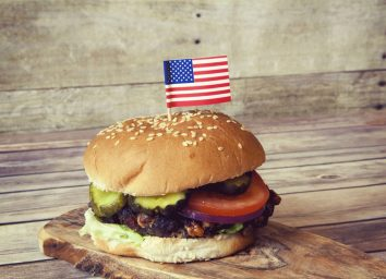 Cheeseburger with tomato onion and pickles