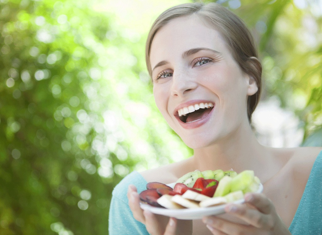 Happy woman with fruit
