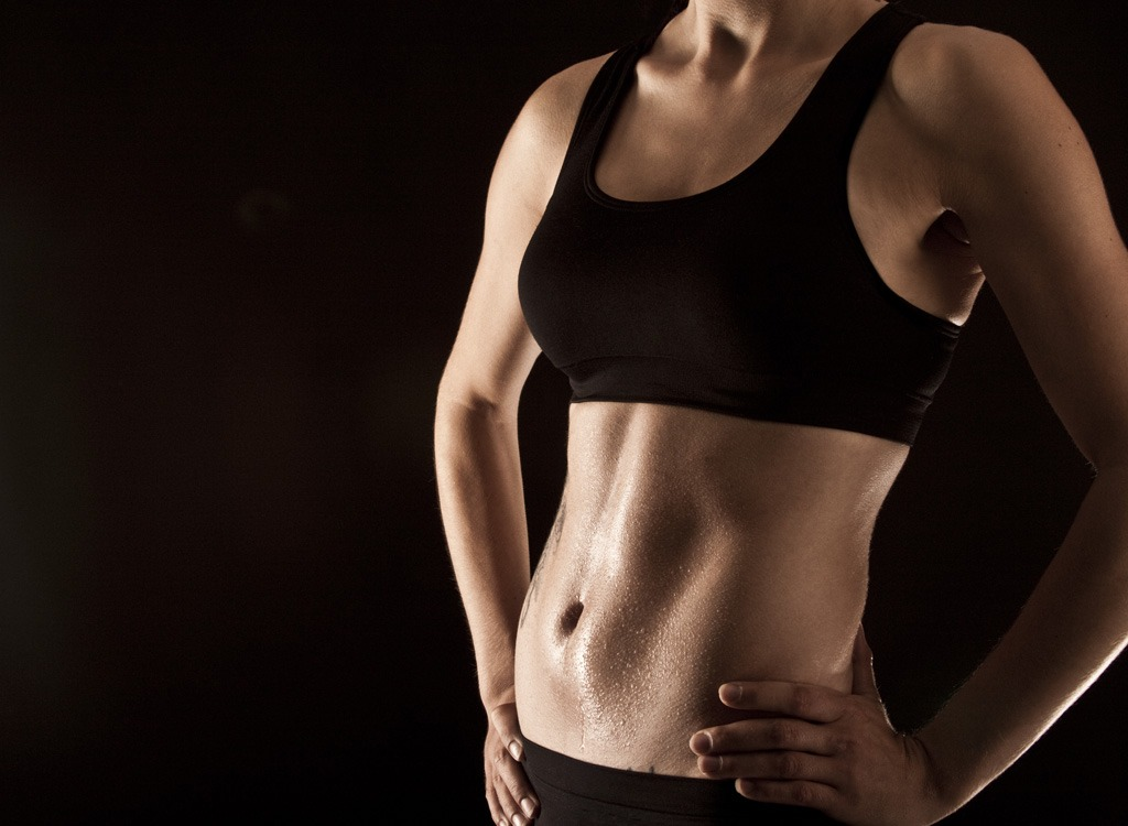 Woman with flat belly and abs