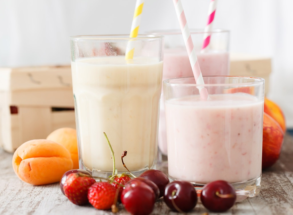 Glasses of fruit smoothies with straws