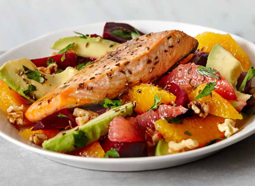 Whole piece of salmon over fruits - best ways to speed up your metabolism