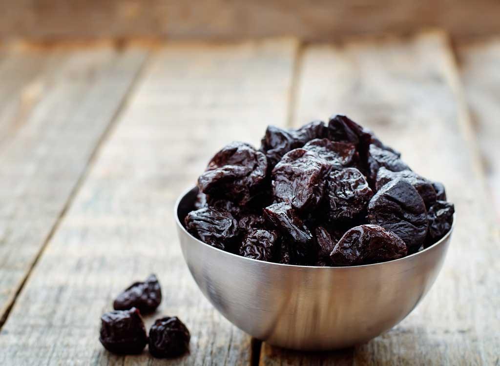 Prunes in a bowl - foods that make you poop