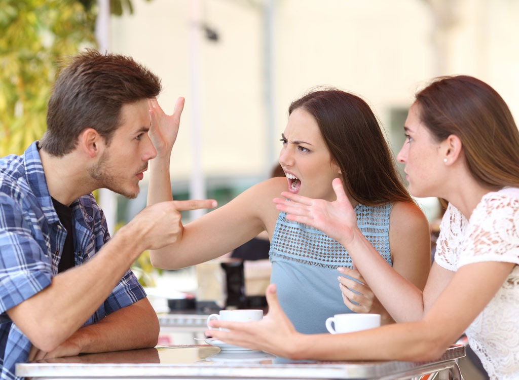 Friends arguing at table