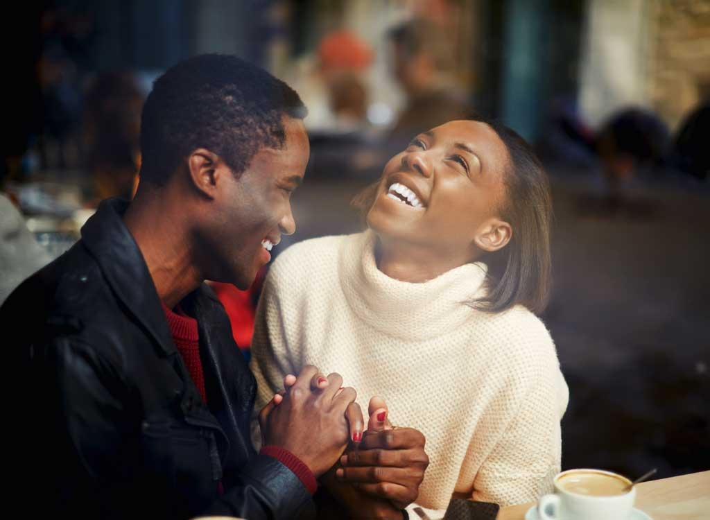 Happy couple smiling lauging together - best ways to speed up your metabolism