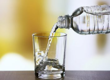 bottled water pouring into glass