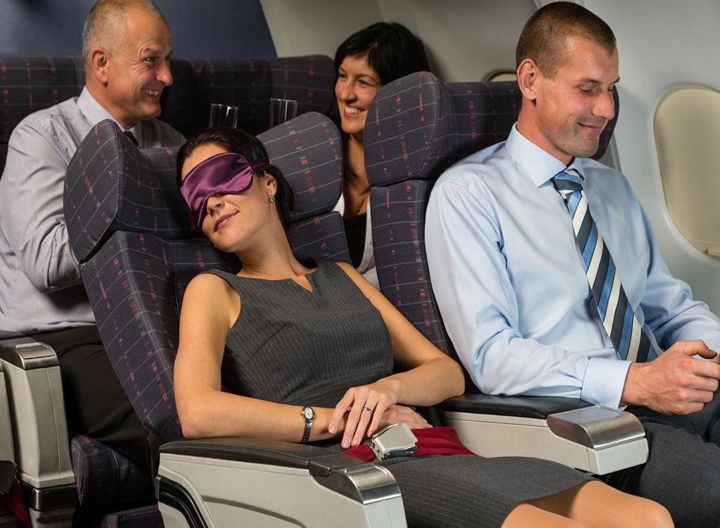 Woman sleeping in the plane