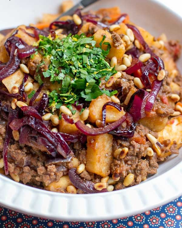yam beef stew with caramelized onions and pine nuts