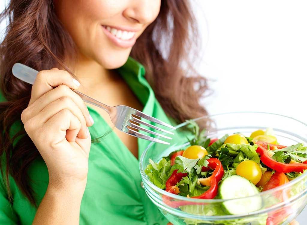 Feel full eat less woman eating salad