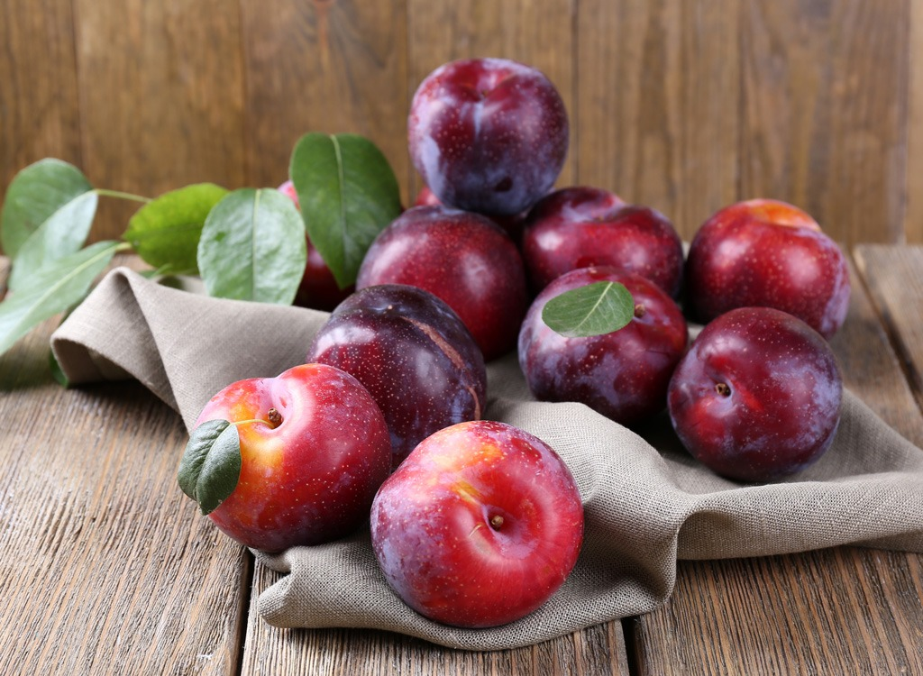 Plums on a cloth - foods that make you poop