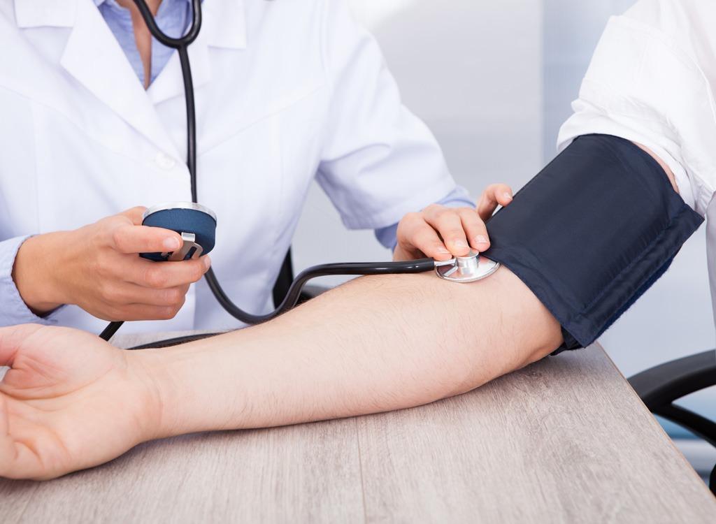 Doctor taking blood pressure reading