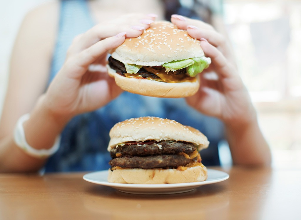 woman eating burgers