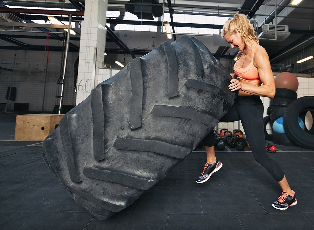 woman lifting tire