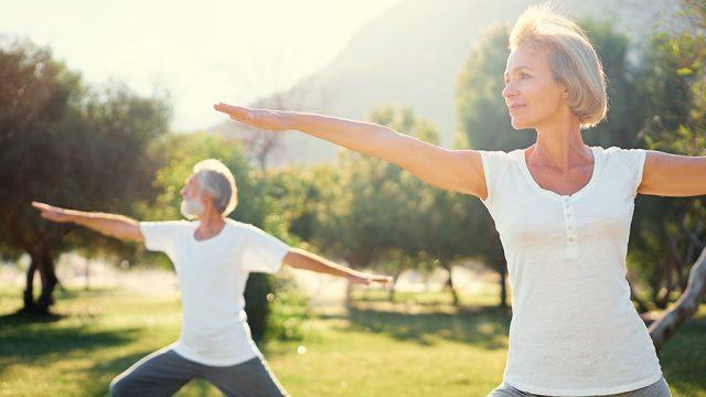 Older couple doing yoga