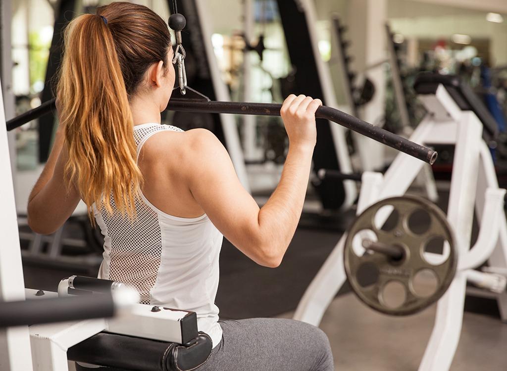 Woman doing lat pulldown at gym