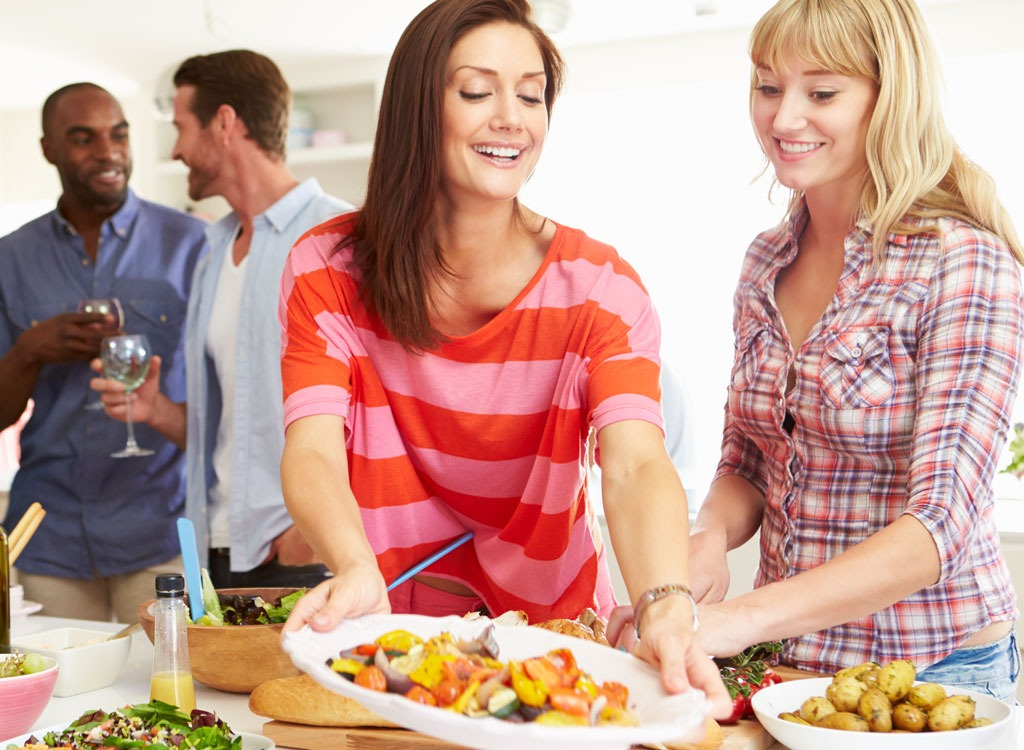 Woman setting party food
