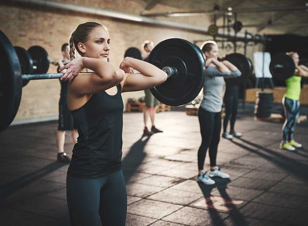 girl lifting large weight