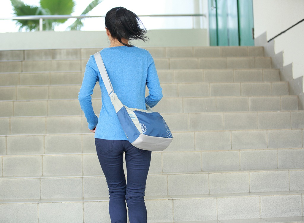 weight loss tips from experts - woman running up stairs