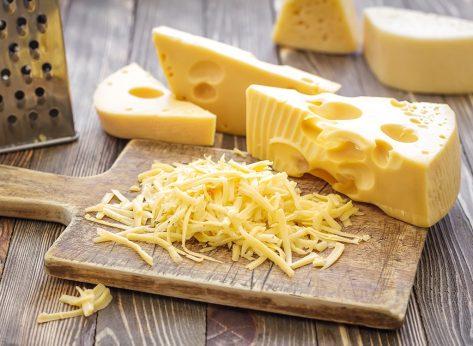 shredded swiss cheese on a board