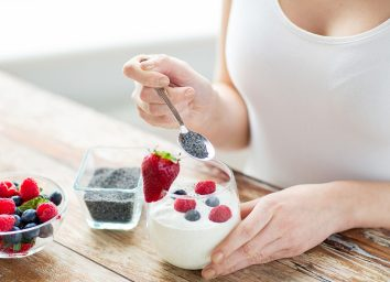 Woman eating yogurt and fruit