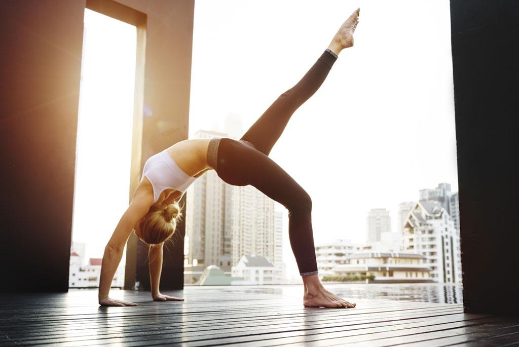Woman doing yoga energetically