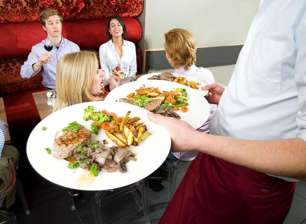 Waiters hands full