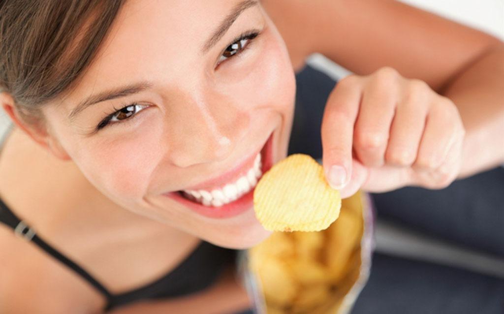 woman holding a potato chip