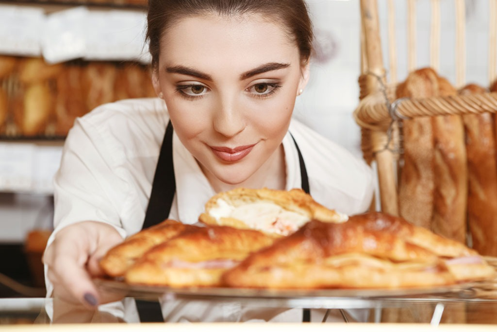 woman serving pastries