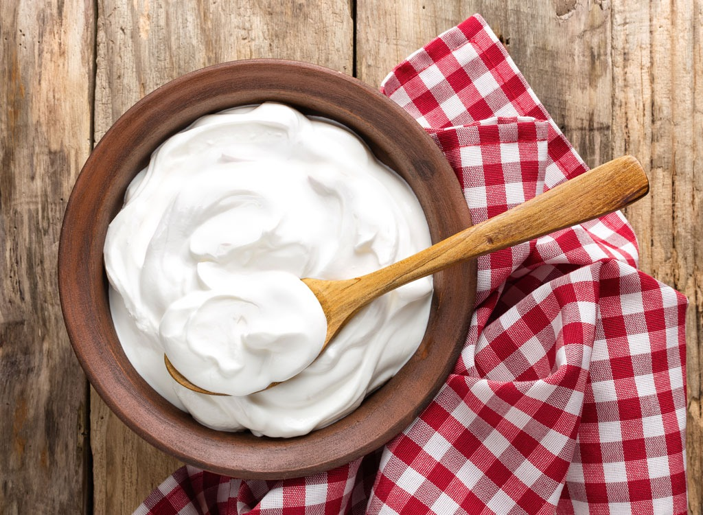 Greek yogurt in bowl with spoon