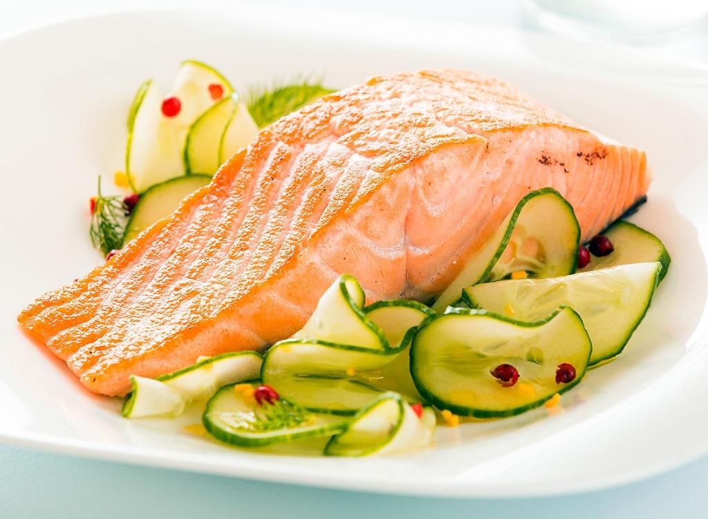 Salmon on veggies in bowl