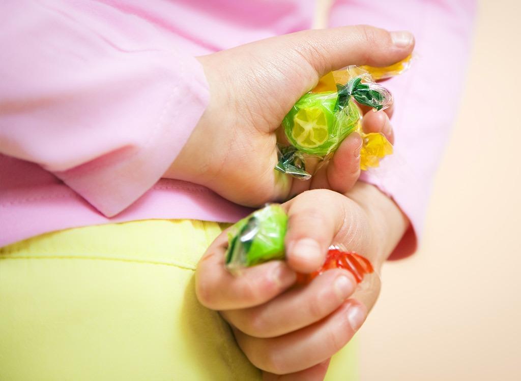 kid hiding candy